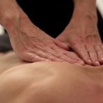 Why Massage Guns and Chiropractic Treatment Go Together